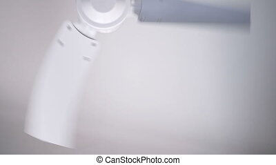 white metal fan spinning on the ceiling