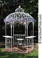 White metal pavilion in the garden