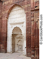 White mihrab in Qutub mosque in Delhi (India) decorated with...