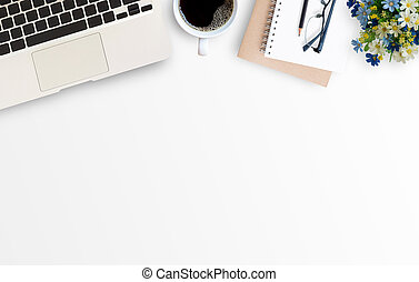 White minimal office desk table with laptop computer, notebook, glasses, pencil, and cup of coffee. Top view with copy space for text or picture, flat lay.