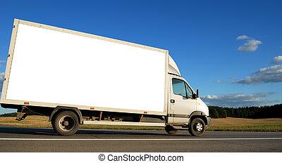 White minitruck - White delivery minitruck moving on the...
