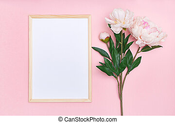 White mock up frame and pink flowers on a multi-colored background