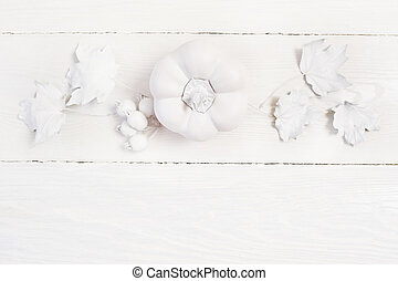 white mockup pumpkin, berries and leaves on a wooden autumn background. Greeting card for Thanksgiving Day in rustic style with space for your text. Flat lay. Top view