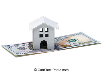 White model of a house on a one hundred dollar bill close up, isolated