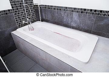 modern bathtub with bubble bath
