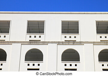 white modern building with clear blue sky