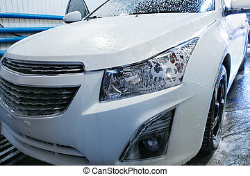 car covered with foam in car wash