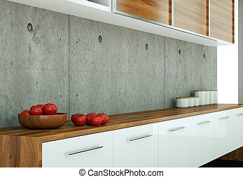 White modern kitchen in a house with concrete wall