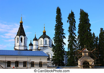 White monastery - On a background of the blue sky a white...