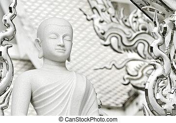 White monk meditation statue