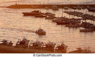 White Motor Boat Arriving at marina of Santa Maria di Leuca at sunset