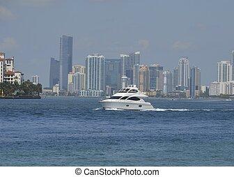 White Motor Yacht and Miami Skyline