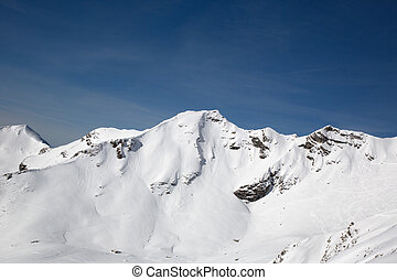 White mountains covered with snow in winter