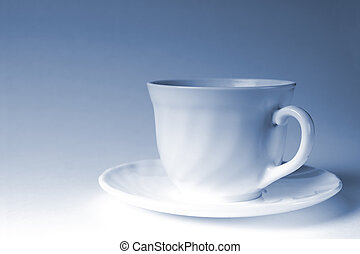 white mug of coffee on a white background, with the admixture of blue tones