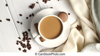 White mug of coffee on table - Top view of white ceramic mug...