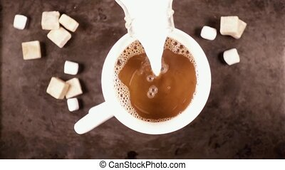White mug on a gray background with a hot drink slow motion