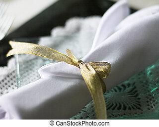 White napkin on a glass plate