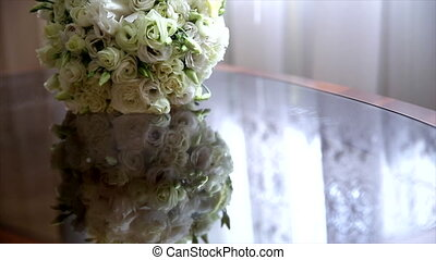 White natural wedding bouquet on glass table