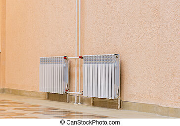 White new radiator on pink wall in building