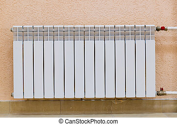 White new radiator on pink wall