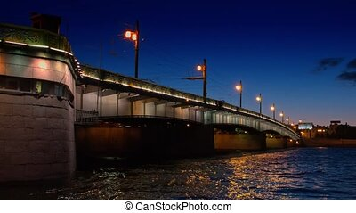 White night view of Neva river with bridge in...