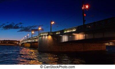 White night view of Neva river with bridge in...