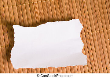 White note on wooden background