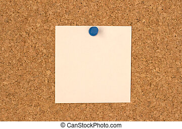 White note pinned to cork board
