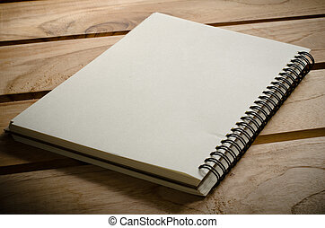 White notebooks laying on a wooden table