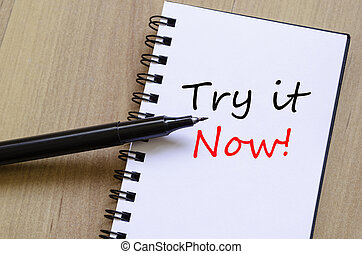 Try it now concept - White notepad and ink pen on the wooden...