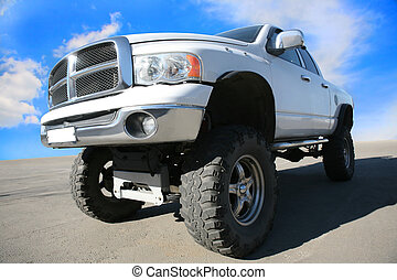 off-road car on the big wheels - White off-road car on the...