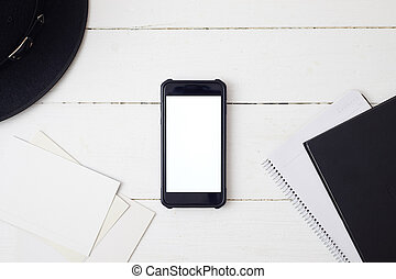 White office desk table with smartphone.
