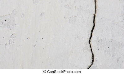 White old building wall with a crack.