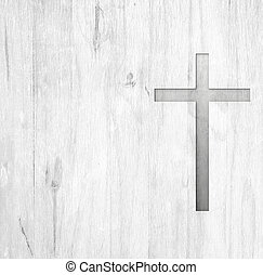 White old christian religion symbol cross shape as sign of belief on a grungy wood textured