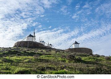 White old windmills on the hill near Consuegra (Castilla La...