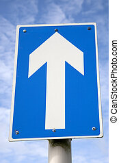 White one way traffic sign against blue sky background