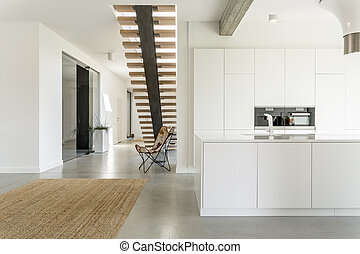 White open kitchen - Apartment with white open kitchen and...