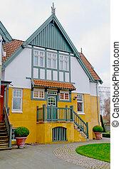 White-orange house with a porch
