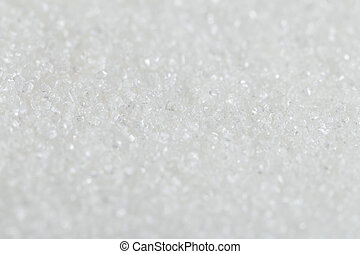 White Organic Cane Sugar against a background. Selective focus