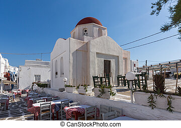White orthodox church and small bell tower in Mykonos, Cyclades Islands
