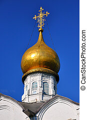 White orthodox church with a golden dome, Sergiev Posad, Moscow region, Russia