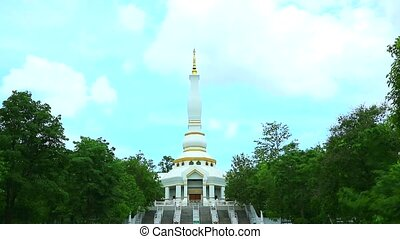 white pagoda in buddist temple on mountain blue sky background time lapse