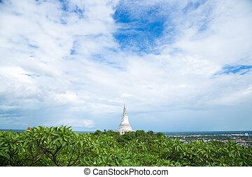 white pagoda on the mountain.