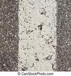 White paint stripe on asphalt