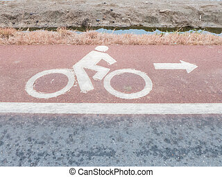 white painted sign for bikes lane