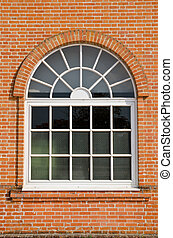 White painted wood arched window