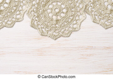 White painted wooden board and a crochet doilies