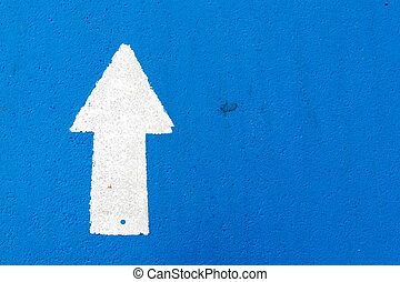 White painting in forward direction arrow symbol on blue concrete road background