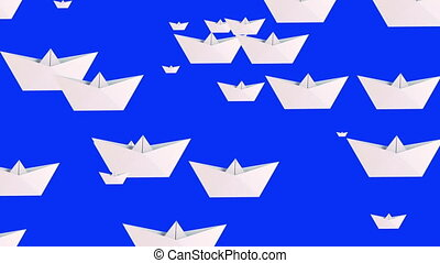 White paper boats on blue