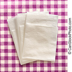 White paper napkins on lilac checked background